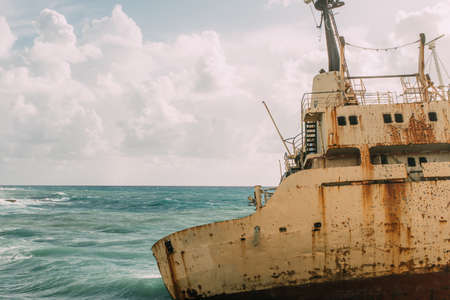 old and rusty ship in blue mediterranean sea Imagens