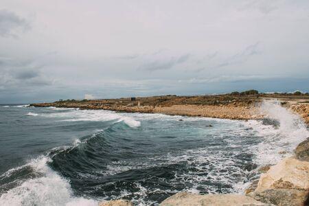 splashes of water form mediterranean sea near coastline Banco de Imagens