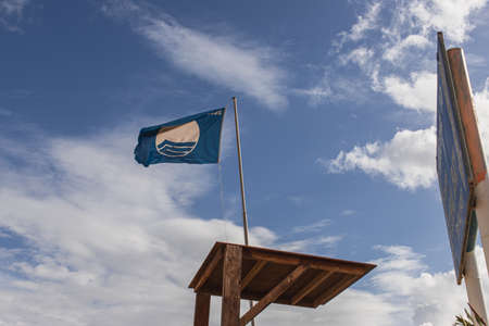 LIMASSOL, CYPRUS - MARCH 31, 2020: low angle view of blue flag as international award of beach excellence
