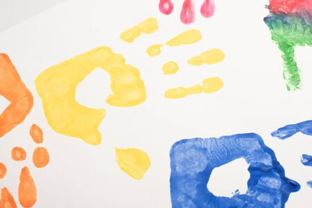 top view of colorful handprints on white for World Autism Awareness Day