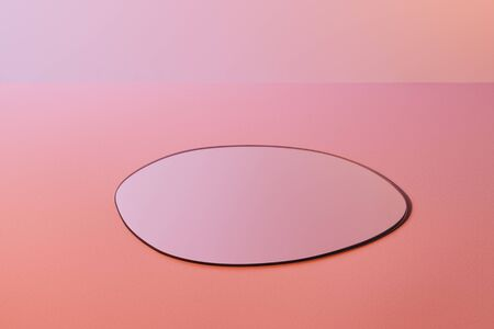round fragile mirror on pink background with copy space