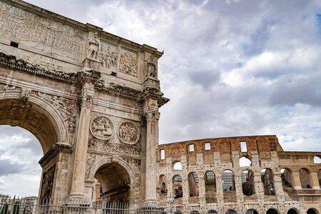arch of titus near ancient colosseum in rome