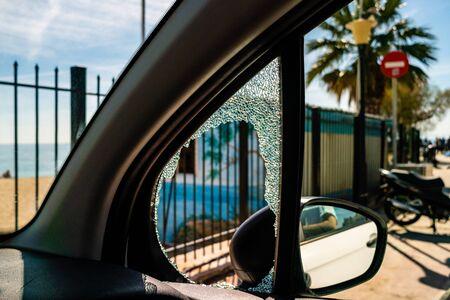 selective focus of sunshine on white car with broken window Archivio Fotografico
