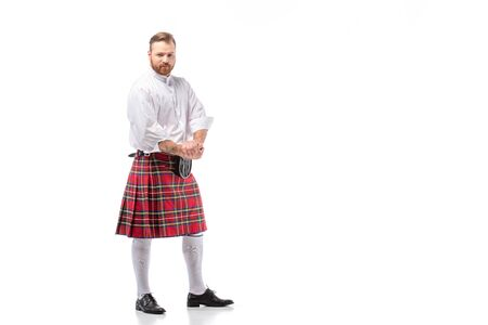 Scottish redhead man in red kilt on white background