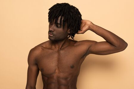 handsome sexy shirtless african american man on beige