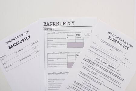 top view of bankruptcy petition papers on white background Banco de Imagens