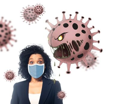 shocked african american businesswoman in medical mask near angry bacteria isolated on white