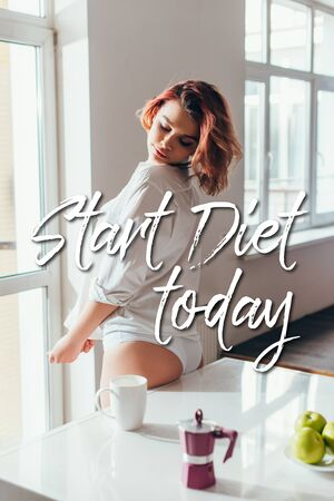 attractive girl on kitchen with apples, coffee pot and cup on quarantine with Start diet today lettering