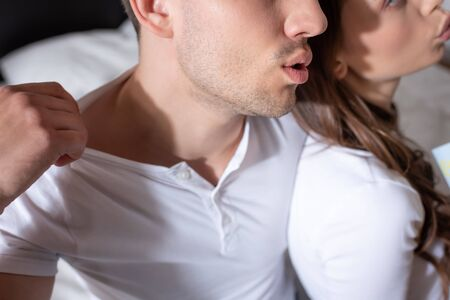 cropped view of man and woman feeling hot at home 스톡 콘텐츠