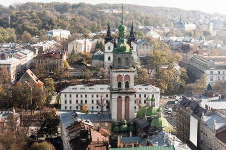 aerial view of carmelite church, korniakt tower and houses in historical center lviv, ukraine