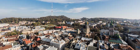 horizontal image of lviv cityscape with dominican church and carmelite church