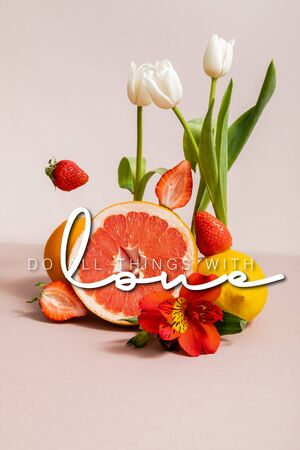 floral and fruit composition with tulips, red Alstroemeria, summer fruits near do all things with love lettering on beige