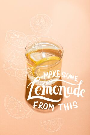 glass of fresh water with lemon slices on beige with make some lemonade from this lettering