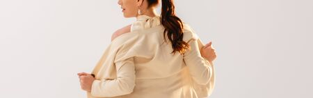 Panoramic orientation of brunette businesswoman taking off jacket isolated on grey Foto de archivo - 150127201