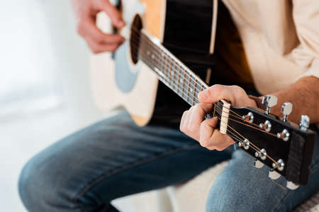 Cropped view of man playing acoustic guitar Stock fotó