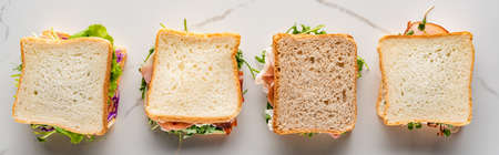 top view of fresh sandwiches on marble white surface, panoramic shot Reklamní fotografie
