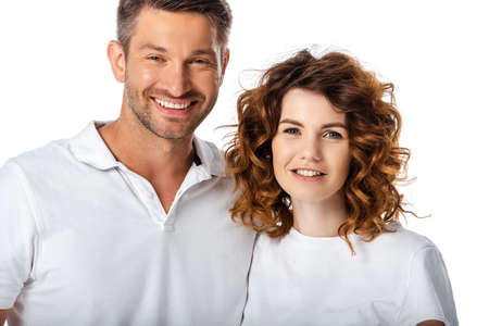 happy husband and curly wife looking at camera isolated on white