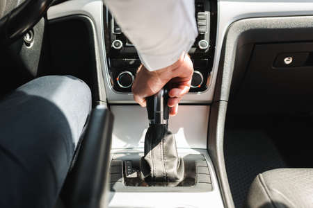 Cropped view of businessman sitting on driver seat while driving auto Reklamní fotografie