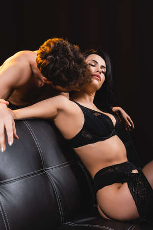 152120582-muscular-man-kissing-woman-with-closed-eyes-in-sexy-underwear-isolated-on-black.jpg?ver=6