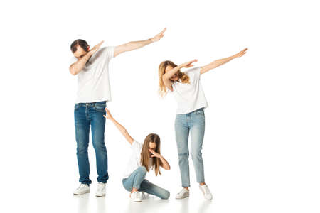 young family showing dab gesture isolated on white Reklamní fotografie