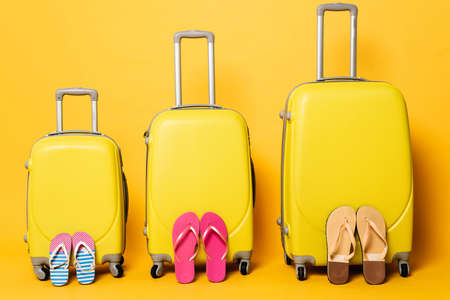 travel bags with family flip flops on yellow