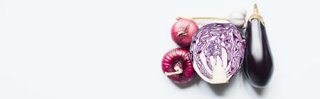 top view of red onion, red cabbage, eggplant and garlic on white background, panoramic shot