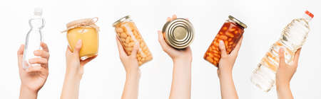 cropped view of woman hands with food isolated on white, charity concept
