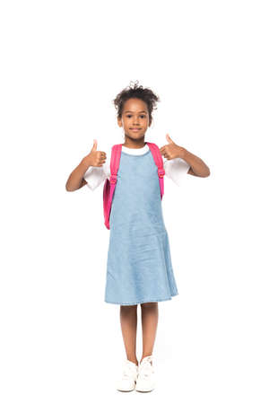 African american schoolkid showing thumbs up isolated on white