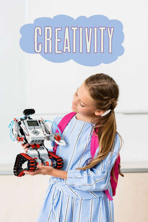 Schoolgirl holding robot near creativity illustration