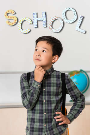 Pensive asian schoolboy looking away near school illustration