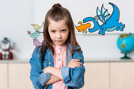 Serious schoolgirl looking at camera near birds and dinosaur illustration