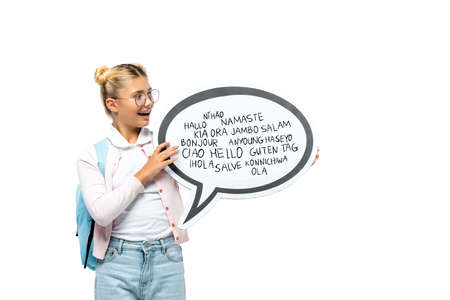 Schoolchild with backpack holding speech bubble with greeting lettering isolated on white