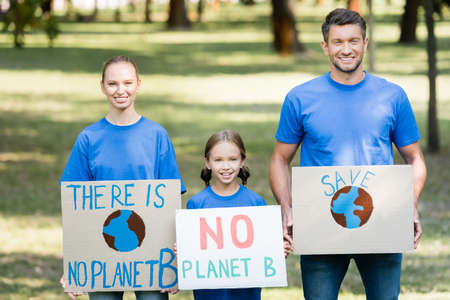 smiling family of activists holding placards with there is no planet b inscription, ecology concept
