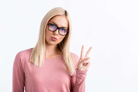 Blonde woman in eyeglasses showing peace sign isolated on white