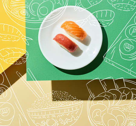 top view of fresh nigiri with salmon and tuna near japanese food illustration on green and yellow surface