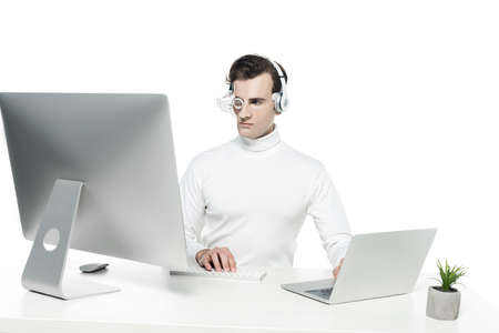 Cyborg using laptop and computer near plant on table isolated on white