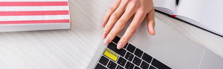 cropped view of interpreter pressing translation key on laptop, banner Stock fotó