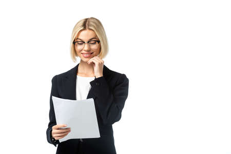 smiling news anchor in eyeglasses holding papers isolated on white