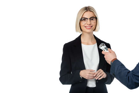 successful blonde businesswoman looking at camera near interviewer with dictaphone isolated on white