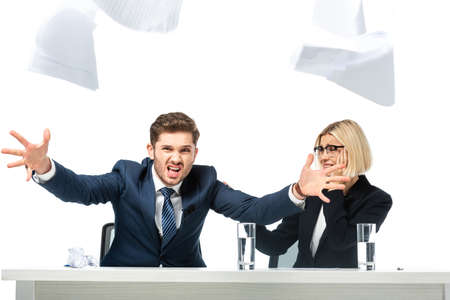 angry news anchor throwing papers near tense colleague isolated on white