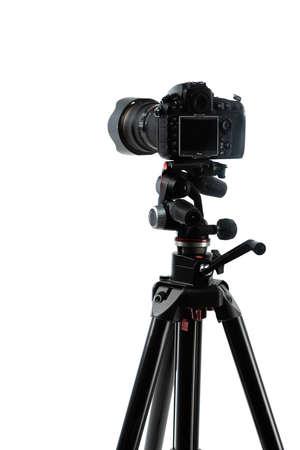 photo camera on tripod isolated on white Stockfoto