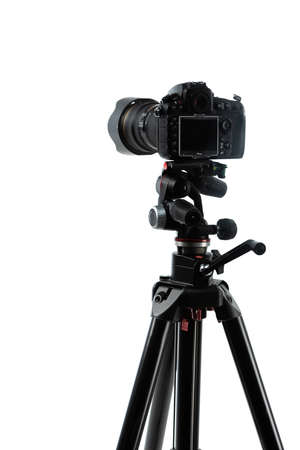 photo camera on tripod isolated on white Imagens