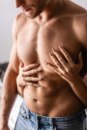 Cropped view of woman touching torso of boyfriend Foto de archivo