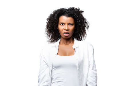 Confused african american woman looking at camera isolated on white
