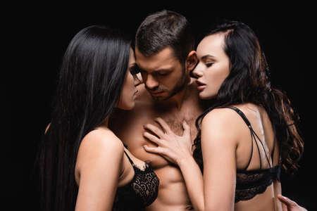 man near seductive, brunette women seducing him isolated on black