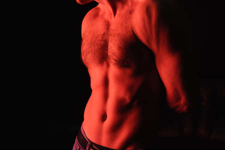 cropped view of shirtless man standing isolated on black