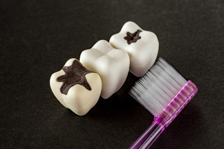 cementum: Tooth decay and toothbrush Stock Photo