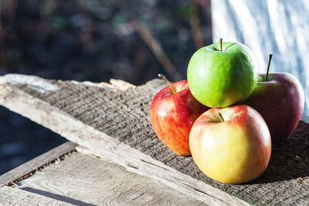 Four apple on wooden board  photo