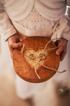 hanged woman: Wedding rings in the hands of the pastor Stock Photo