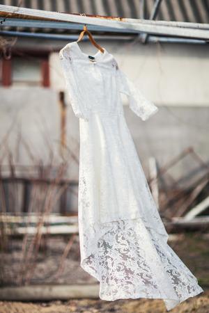 hanged woman: Beautiful wedding dress on a hanger
